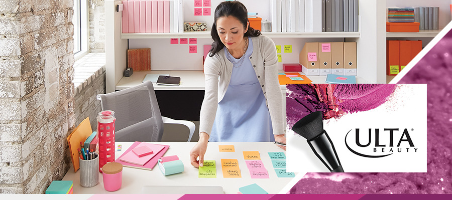 Woman Organizing Office with Post-it Notes
